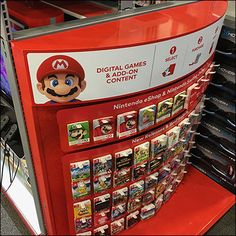 Brilliant red and all-metal, this XBox Curved-Endcap Pick-Card Merchandising is a stand-out in-store. And Mario's famous face quickly communicates this is Retail Fixtures, Xbox Games, Famous Faces, Jukebox, Hooks, Cool Things To Buy, Butterfly, Display, Digital