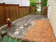 Complete with fire hydrant, this simple backyard is paradise for any pooch. Down to Earth Landscaping in Bellevue, Washington, designed this canine-friendly creation, making-over an existing yard. Mucky mud was replaced with gravel for better drainage, while dog friendly cedar chips brighten the area and make for an easy potty area.