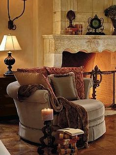 Kick back, relax and unwind after a busy day atop the plush Rosamund Cuddle Chair that features five down-filled pillows and 360-degree swivel for ultimate comfort.