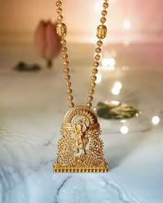Explore exquisite temple jewellery inspired by temple art and architecture. This sublime collection of gold jewellery from Tanishq is an embodiment of grace and magnificence. Pendant Jewelry, Jewelry Art, Antique Jewelry, Gold Jewelry, Jewelery, Jewelry Shop, Gold Necklace, Gold Earrings Designs, Gold Jewellery Design