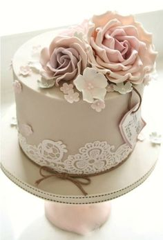 one tier pastel colored wedding cake with buttercream rose topper