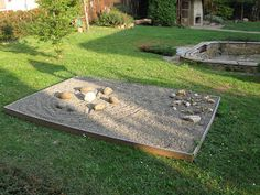 This Zen Garden in a Czech infant school is a lovely example of an attractive gravel pit. Children can make large scale stone art by drawing and raking in the gravel and moving around the stones.