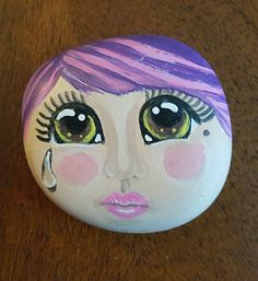 Painted rock sad doll face by StoniesbyHeidi on Etsy
