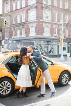 What is more New York than a yellow taxi? NYC engagement shoot: Photography : Love Ala Read More on SMP: http://www.stylemepretty.com/2016/09/07/classic-fall-engagement-new-york-city/
