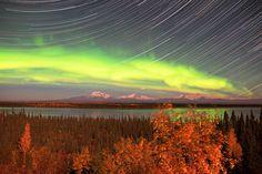 AuroraOver Willow Lake and the snowy Wrangell and Saint Elias Mountains in eastern Alaska, USA.