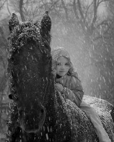 Girl on horse in snow
