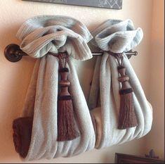 DIY Decorative Bath Towel Storage Inspiration : using two drapery tassels, secur. DIY Decorative Bath Towel Storage Inspiration : using two drapery tassels, secure two towels over towel rack and add towels inside. very clever bathroom decor! Hang Towels In Bathroom, Small Bathroom, Bathroom Ideas, Bathroom Staging, Bathroom Towel Display, Guest Bathrooms, Hanging Bath Towels, Design Bathroom, Brown Bathroom Decor