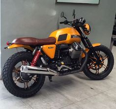 One of our customized #motoguzzi #v7ii #stone #italianpride #yellow #custom #kenziemotoworks