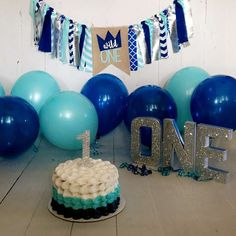 baby boy first birthday photo shoot cake smash one letters  blue and silver
