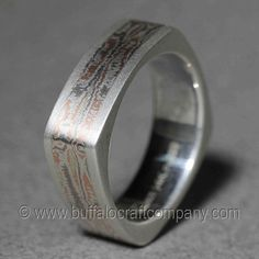 """""""Paige""""Mokume Ganemen's wedding band Hand fabricated custom men's wedding band. This Square sterling silver comfort fit band includes tri-color (14k rose gold, 14k palladium white gold and argentium sterling silver)Mokume Gane inlay."""