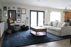 Chris Loves Julia | How a big blue rug totally changed our living room. (a 10x14 Crate and Barrel Baxter Area rug in Indigo)