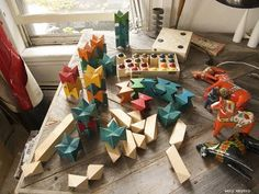 Spiel Naef wooden toys from Switzerland - the stacking pointy blocks were at the bottom of a cardboard box of other wooden blocks from the flea market and the box of Kugelbau was from a yard sale. The Dala horses are from various places, found one at a time until before we knew it we had a whole herd.