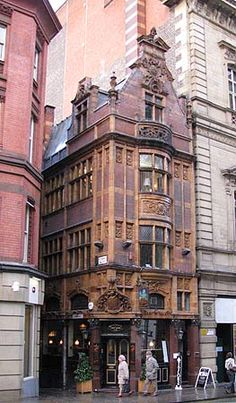 I love this little gem tucked between two larger buildings. How wise not to tear it down. Manchester, England
