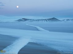Wind sweeps snow into a drift toward Iceland's Hverfjall Crater.  (photo by Orsolya and Erlend Haarberg)
