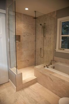 Spa retreat! Tile walk in shower with square soaker tub