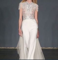 Chic, sophisticated bride in a JUMPSUIT!!! Deco beaded jewel neck bodice, luscious silk crepe pants and tulle train - wonderfully confident bride!