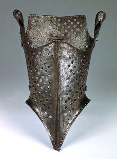 In 1556 The earliest known busk was made in iron. Fabrics like damask required a stronger, supported construction to show a body's shape. The first   artifical support was made in Italy was called a choche later became known as a busk in England. Corsets were even talked about by Geoffrey Chaucer, the father of English Literature, in his books during this time.