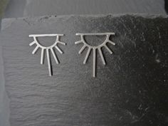 Sunburst sterling silver sunshine earrings. The sun is symbolic of illumination, life force, vitality and the source of life on earth. The Sun tarot symbol heralds a new and better day.  Handmade jewellery. British design. Made in UK. London designer. Modern and minimalist jewellery. Art deco inspired.