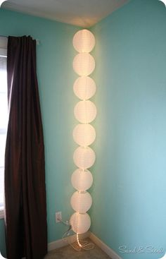 Paper Lantern Light- hang like a garland over a fire place but instead of over a fire place hang from one corner of a wall to the next for ambient lighting