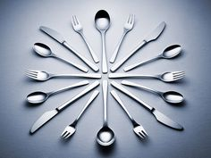 Large set of cutlery displaced in clock arrangement  - Martins Ribeiro