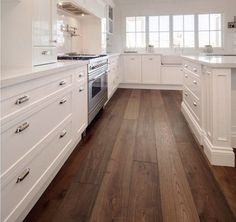 Love the floor. Maybe darker counters with the cabinets
