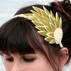 something similar but a little more elegant looking that blocky felt for a hair piece would go well with the 'tweed' style