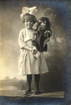 """We are completely charmed by this week's vintage photograph. Don't you just love that bow! See if you can guess the doll- Our only clue is that the photograph has handwriting on the back reading, """"Jointed Bisque Doll, 1900."""" http://Theriaults.com"""