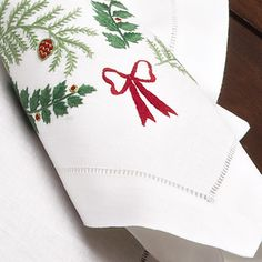 Let the festivities begin with elegance designed to set a new holiday tradition. Hand-embroidered with boughs of holly and bows in Green and Red,...
