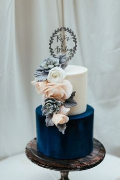 Impress guests with a stunning two=tier color-blocked wedding cake.