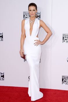 KATE BECKINSALE – wearing an elegant white Kaufmanfranco dress with cut out details, Kate Beckinsale looked nothing short of a goddess. Her dress fitted like a glove and hugged her in all the right places, showing off her sexy curves. Her simple neutral makeup and the accessories she wore with the dress completed the whole look to perfection.