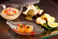 Food presentation with glass sauce bowl and appetizer dish