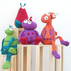"""They come in peace - bright and cuddly little aliens to tickle anyone's fancy! Ranging in height from 7"""" to 8"""", these knitted toys are just the right size for toting along on a little one's adventures"""