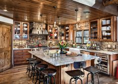 Beautiful rustic modern kitchen featured in the High Falls Lodge plan. Visit our website to see more pictures of this stunning home. Butcher Block Tables, Hickory Cabinets, Two Sided Fireplace, Cool Kitchens, Rustic Kitchens, Country Kitchens, Log Cabin Kitchens, Timber House, Log Homes