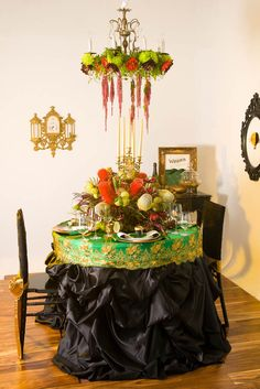 LOVE this centerpiece chandelier duo! The tablecloth is fantastic as well.
