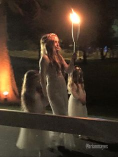 Lisa Marie and her twins starting the candlelight vigil for Elvis at Graceland, Aug. 16, 2015.