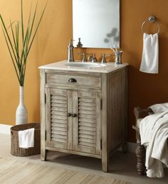 furniture aesthetic cottage style bathroom furniture with unfinished wood cabinets using louvered door panels and oil rubbed bronze drawer cup pulls under white marble vanity top