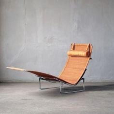 Poul Kjaerholm (1929 - 1980) Chaise Longue PK 24 stainless steel, wicker, leather Denmark H 86 cm x W 155 cm x D 67,5 cm Produced by Fritz Hansen