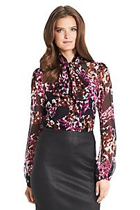 The Jezebel top is the perfect work blouse in a sophisticated, printed chiffon.  http://on.dvf.com/1eLkmXu