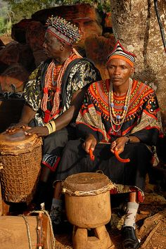 (14) And there are so many ways to tell a story. Stories come through songs and music, through images, through art and artifacts, through clothing and ways of being. [Drum players. North West Region, Cameroon.]