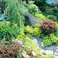 For maximum visual interest in your rock garden, play with texture and vary the scale of plants and rocks. A mixture of conifers, shrubs, and perennials works beautifully to create a lush landscape that blends distinctive foliage and colorful blooms. Boulders, Mexican pebbles in a dry creek bed, and bricks in the winding pathway lend natural texture and additional drama./