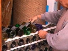 Building earthship walls using wine bottles: the convection holds heat and slowly releases it in the winter. In the summer, the bottles insulate the walls from the hot outside air.