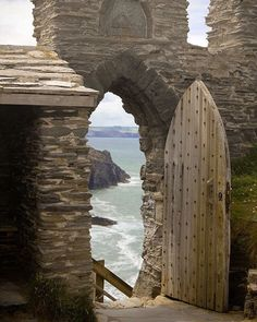 Medieval Tintagel Castle ruins ~ birthplace of King Arthur with rugged,clifftop backdrop, Cornwall, England. I love the door and the old world look it has. I can only imagine how this castle looked in the middle ages or before when it was in use. Oh The Places You'll Go, Places To Travel, Places To Visit, Roi Arthur, Castle Ruins, Medieval Castle, Abandoned Places, Belle Photo, Dream Vacations