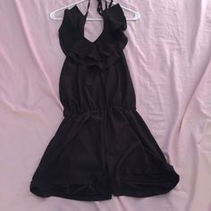 Black satin romper Black satin halter top romper with gold details on the end of the tie strings and ruffle detail in the front. Only worn once, like new! WINDSOR Dresses