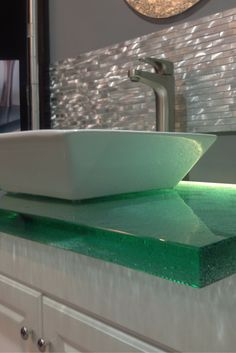 Love how this cast glass countertop with LED lighting shines through the counter. Click through to learn more.