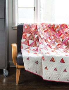 It's no surprise that Designer Tanya Finken named this quilt Trifecta — the entire quilt is made up of triangles. It may look complicated, but it's nothing more than cutting triangles from strip sets. Digital pattern available! #FonsandPorter #white #quilt #project #stripsets