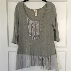 Anthropologie | Gray ruffled blouse This top is so unique and adorable!! Material is 60% cotton, 40% modal. Hand wash to preserve the beautiful details. Pre-loved but in great condition! Anthropologie Tops