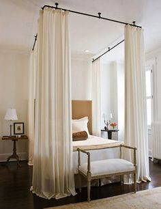 canopy bed..easy way to do this yourself..buy large hooks to screw into the ceiling and some pvc pipe. Paint the pipes and hang! I wonder if I could make the frame removable.  I only want the canopy in winter...