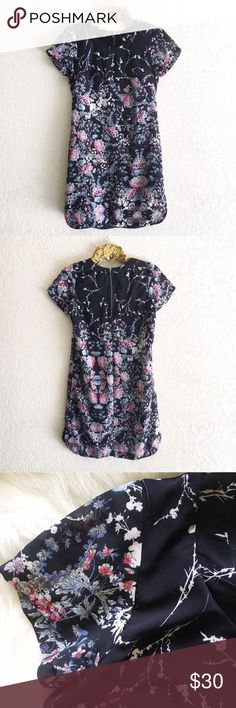 """Floral Shift Dress Fetching short sleeve dress with colorful floral pattern over midnight blue. This is a re-posh that didn't fit. In excellent condition. Brand is Japna; only listed as anthropologie for exposure.   Details:  * Exposed back zipper * Small side slits  * Length: 34.5"""" * Armpit to armpit: 18"""" Anthropologie Dresses Midi"""