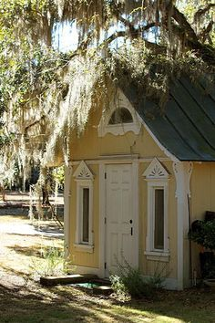 Tiny yellow cottage complete with Spanish moss draped tree ... perfection.