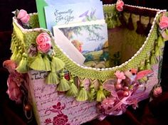 This fun storage box is both attractive and very useful. I store a supply of greeting cards in mine, but it would also be a marvelous magazine holder. I selected pink, rose, and lime green for my colors; choose any combination that appeals to you. Directions at www.DoveOriginalsTrims.com